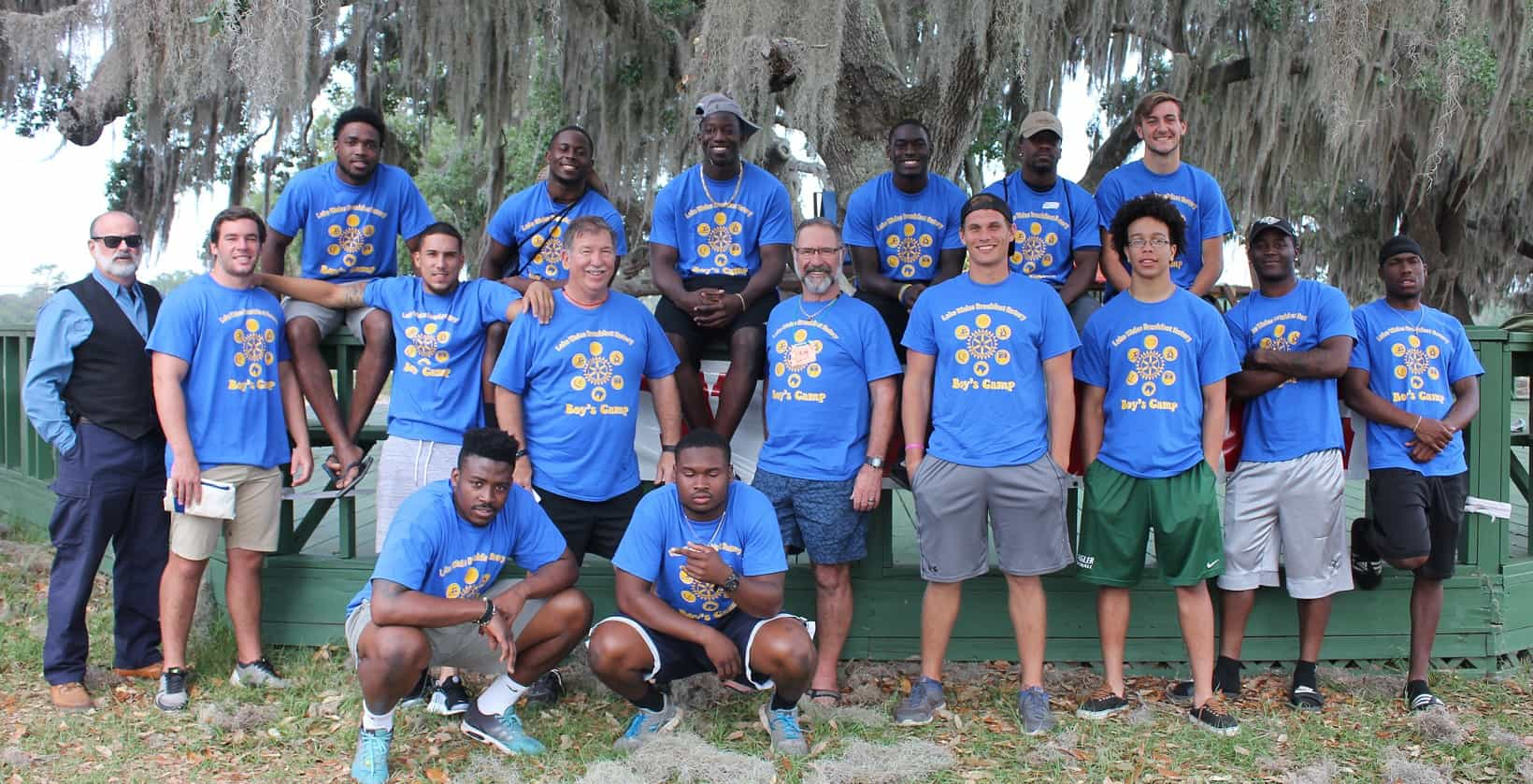 Football Players Volunteer at Camp