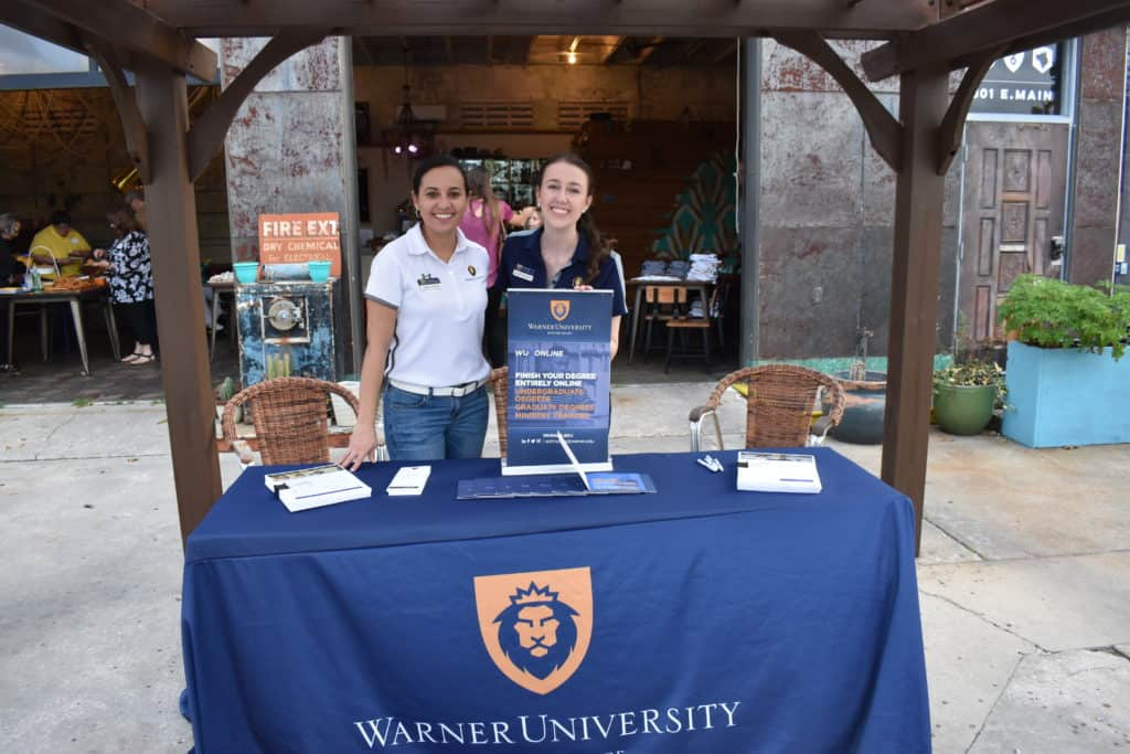 Warner graduate admissions team set up at the Warner University Alumni gathering